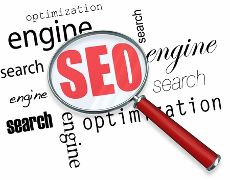 seo: A magnifying glass hovering over several words - search, engine, optimization, focusing on acronym SEO