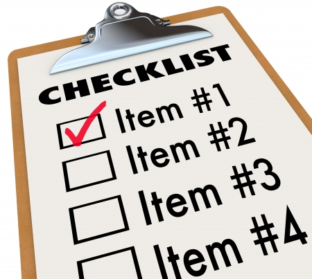checklist: A checklist on a wood and metal clipboard with a check next to the first item, a list of things you have to do today - tasks, to-dos, chores or other items