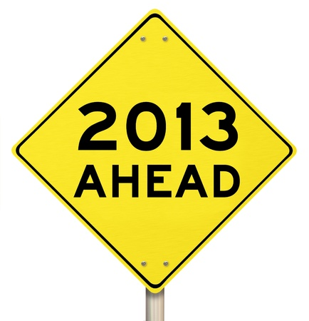 new opportunity: The words 2013 Ahead on a yellow yield sign to mark the challenges and opportunity and hopes for a new year