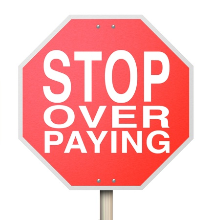 A red octogon shapped sign with the words Stop Over Paying Stock Photo - 17674296