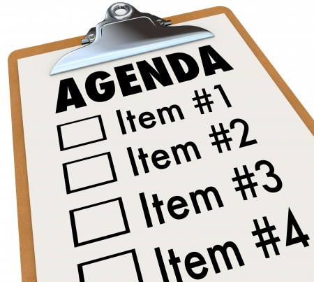 work task: The word Agenda on a numbered list of things to do or cover, held on a clipboard, serving as a schedule for a meeting or gathering