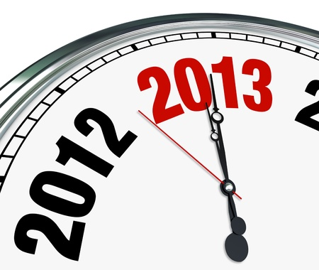 The year 2013 is quickly approaching according to this white clock with hands pointing to the number for the new year Stock Photo - 17800966