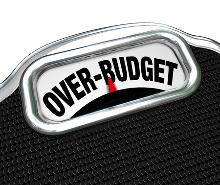 The words Over-Budget on a scale, illustrating financial problems such as debt, deficit, over spending, lack of savings, bankruptcy and other economic trouble photo