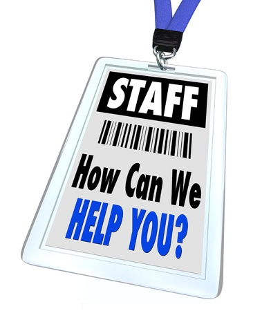 help: A badge and lanyard with printed pass reading Staff and How Can We Help You Stock Photo