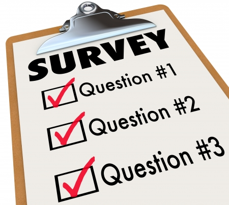 survey: A checklist on a wooden clipboard with the word Survey and a list of questions to gather customer or audience feedback, reviews and reactions to important matters or products