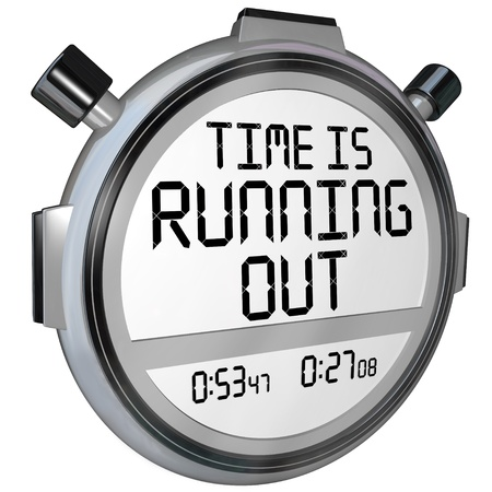 cutoff: A stopwatch or timer with the words Time is Running Out to warn you that the clock is ticking and the deadline or finish point is near and you should hurry or speed up to complete the game or job Stock Photo