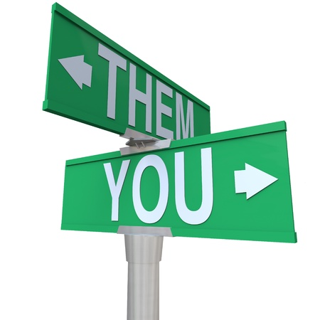 unequal: The words You and Them on a two-way street sign to symbolize choice between yourself and a competitor or opponent for a job or goal in business or life