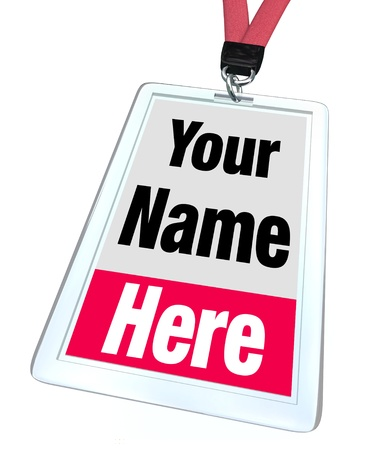 attend: The words Your Name Here on a plastic nametag badge and lanyard for a special event, convention or conference Stock Photo