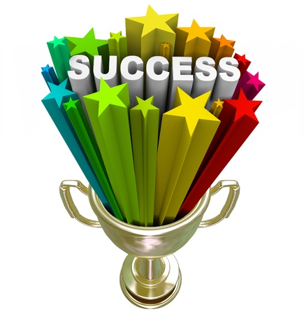 first place: A golden first place trophy with the word Success and colorful stars shooting out of it, symbolizing achieving a major goal Stock Photo