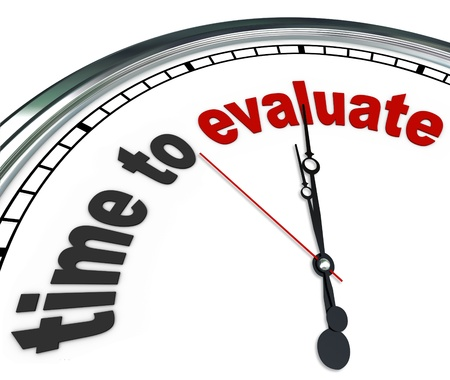 assessment: The words Time to Evaluate on an ornate white clock, counting down to the moment a manager will perform an evaluation, review, assessment or reevaluation of a worker, property or process