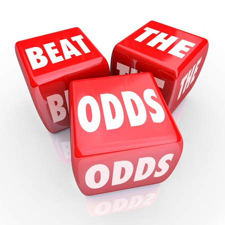 odds: Three red dice with the words Beat the Odds on their faces, symbolizing the risks and rewards of gambling