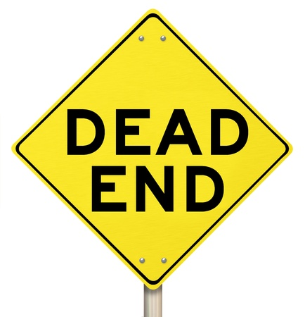 closure: A yellow warning sign with the words Dead End illustrating the closure of a road for an obstruction or no exit telling you to find another way out