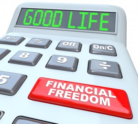 La Vida Buena palabras en una pantalla de la calculadora digital, simbolizando siendo el lujoso estilo de vida que uno puede permitirse cuando el dinero ya no es una preocupación, y un botón rojo con las palabras Libertad Financiera Foto de archivo - 17944282