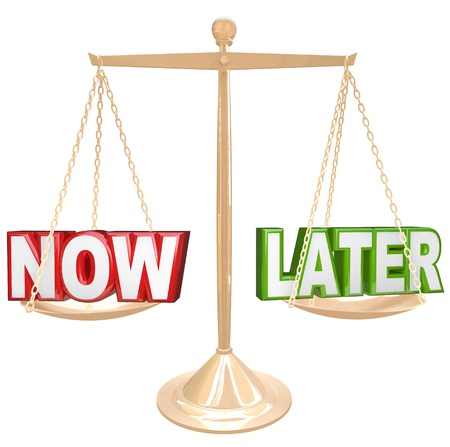 later: Weighing the pros and cons of completing a task now or procrastinate, with the words Now and Later on opposite ends of a scale or balance