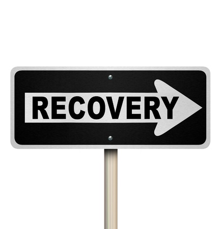 road to recovery: The word Recovery on a one-way arrow street or road sign pointing to improvement, growth, rejuvenation, increase or getting better in health, work, economy or life