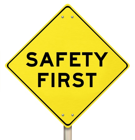 cautions: A yellow diamond-shaped road sign cautions Safety First