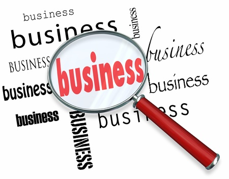 starting a business: The word Business under a magnifying glass, symbolizing the search for principles and concepts of starting a new successful company