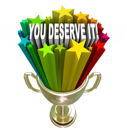 excite: Appreciation and Recognition symbolized by a gold trophy with a burst of stars shooting out of it with the words You Deserve It, a sign of merit and worthiness for your efforts Stock Photo