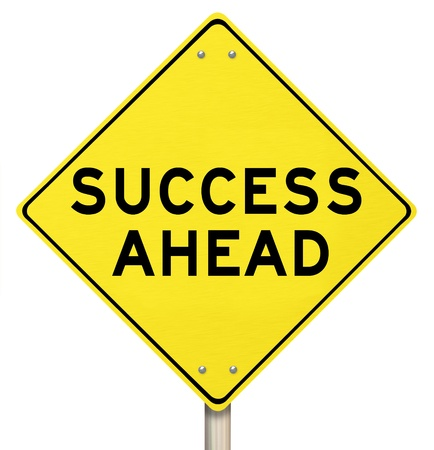 cautionary: A yellow diamond-shaped road sign reads Success Ahead Stock Photo