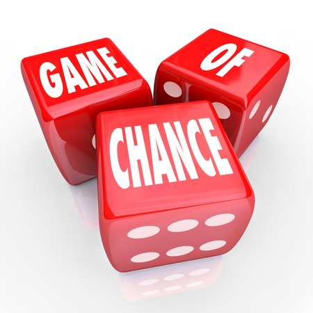 games of chance: Three red dice with the words Game of Chance on their faces, symbolizing the risk and danger of playing a game involving gambling and betting money or your future
