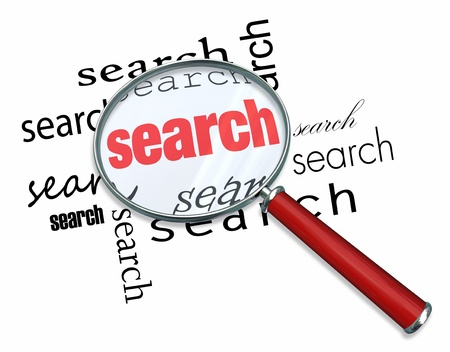 clues: A magnifying glass hovering over the word Search Stock Photo