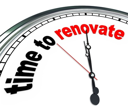 reconstruct: The words Time to Renovate on an ornate white clock, counting down to the moment you will rebuild or take on a reconstruction do it yourself project or as part of a renovation team