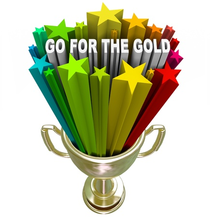 The words Go for the Gold shoot out of a golden trophy to encourage you to set your sights high and try to be the best and win the game, lifting your attitude and ambition Stock Photo