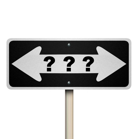 cautionary: A road sign with question marks and arrows pointing left and right Stock Photo