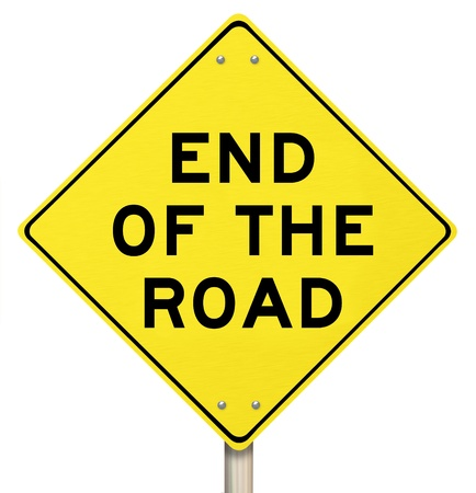 warns: The words End of the Road on a yellow warning sign representing a dead-end street or a failed effort at success, signalling the final, last failure and an indicator of cancellation or termination