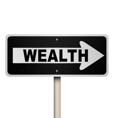 A road sign with the word Wealth and arrow pointing right photo