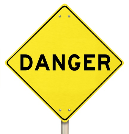 cautions: A yellow diamond-shaped road sign cautions people that Danger is ahead