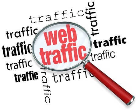 visitors: A magnifying glass hovering over several instances of the word traffic, symbolizing the search for ways to boost and analyze web traffic on the Internet