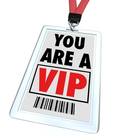 A badge and lanyard with printed pass reading You are a V.I.P. Stock Photo