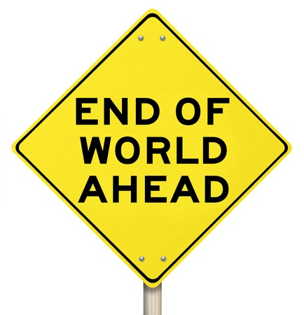 A yellow diamond-shaped road sign cautions people that the end of the world is ahead photo