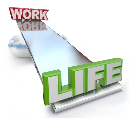The words Work and Life on a see-saw balance scale, showing that you should give greater weight to your life and keep your working life, career and job in perspective photo