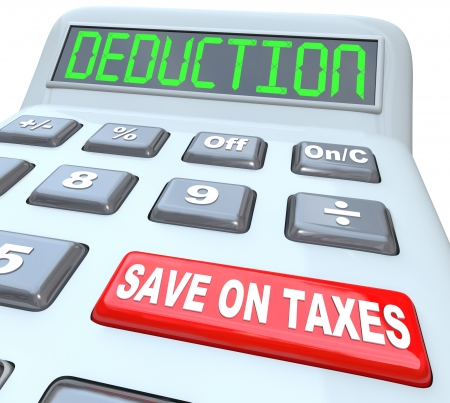 loopholes: A calculator red button with the words Save on Taxes and the term Deductions on the display, illustrating tax savings in the form of loopholes, losses and exemptions Stock Photo