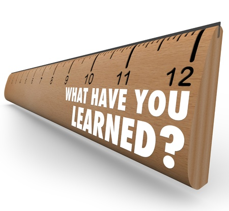 The question What Have You Learned? on a wooden ruler asking you to assess what knowledge you have attained through education, training or other life experience photo