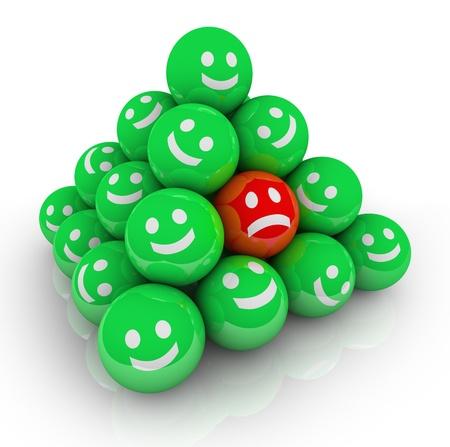 buena salud: La tristeza, la depresi�n, el aislamiento y la soledad est� simbolizada en esta imagen de un rostro ce�udo entre muchos rostros sonrientes