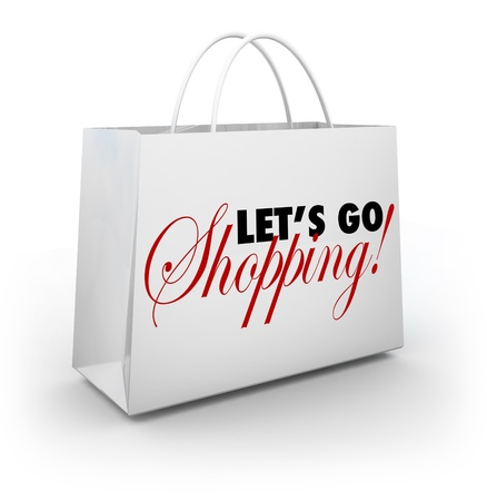 merchandise: The words Lets Go Shopping on a white shopping bag for buying merchandise at a store during a sale or special clearance savings event Stock Photo