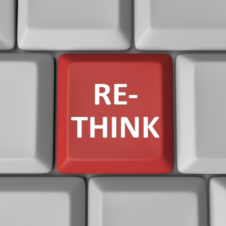 redesign: A red computer key with the word Re-Think to illustrate the need to reconsider and reevaluate an important matter