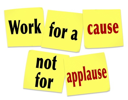 charitable: The saying Work for a Cause Not for Applause on yellow sticky notes telling you that it is better to strive for a noble mission or goal than to seek recognition or appreciation Stock Photo