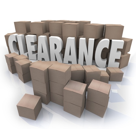 warehouse storage: The word Clearance surrounded by cardboard boxes and packages in a storeroom or stockroom, an overstock supply of products on sale to be cleared out Stock Photo