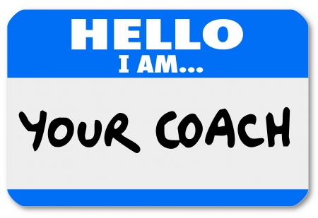name tag: A namtag sticker with the words Hello I Am Your Coach to represent your life advisor, mentor, manager, leader or other person offering moral support or help Stock Photo