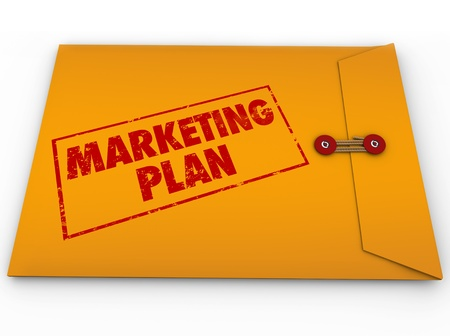 marketing plan: A yellow envelope with a red stamp with the words Marketing Plan to give you advice on a strategy for achieving business success and goals Stock Photo