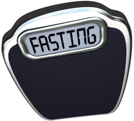 Het woord Vasten op een digitale weergave van een schaal naar de nieuwe 05:02 dieet rage of rage waarin je calorieën te verminderen voor twee dagen en eet normaal gesproken gedurende vijf vertegenwoordigen