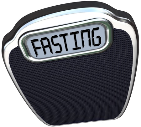 weighing: The word Fasting on a digital display of a scale to represent the new 5:2 diet fad or craze in which you reduce calories for two days and eat normally for five