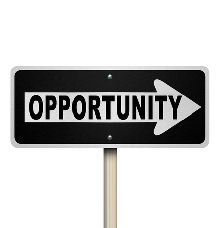 A road sign with the word Opportunity and arrow pointing right to symbolize a chance or moment for success in a job, career or life Stock Photo