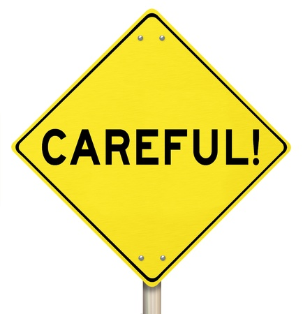 The word Careful on a yellow road sign to warn you to be safe from danger or other hazards