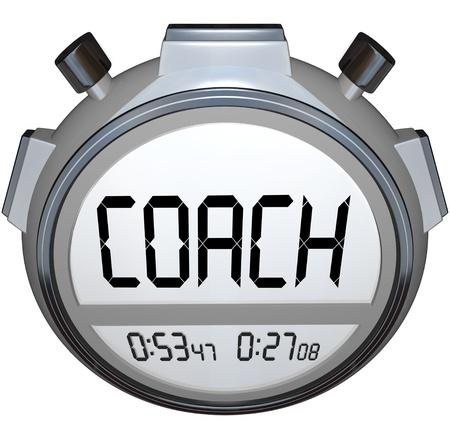 Het woord coach op een stopwatch of een digitale timer om u te trainen om te concurreren en te slagen in het leven, sport of een carrière Stockfoto