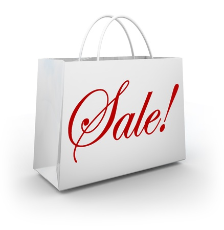 The word Sale in red cursive script lettering on a white paper shopping bag for a store holding a discount or special clearance event Imagens